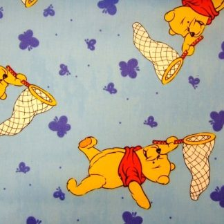 WINNIE THE POOH  by DISNEY COTTON FABRIC LIGHT BLUE