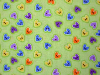 BUTTONS HEARTS COTTON FABRIC by EBOR - MULTI ON GREEN -