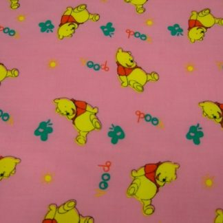 POLY/COTTON PRINT FABRIC -  POO BEAR ON  PINK