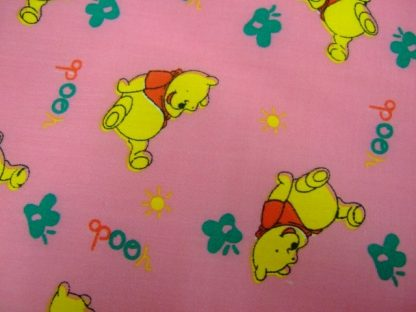 POLY/COTTON PRINT FABRIC -  POO BEAR ON  PINK