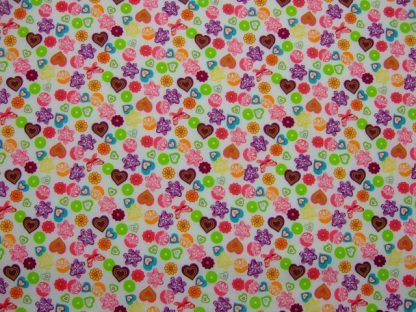 POLY/COTTON PRINT FABRIC -HEARTS- PRIMARY COLOURS ON WHITE